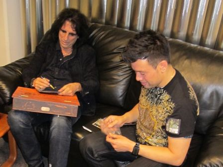 Alice Cooper signing my Feed My Frankenstein CD