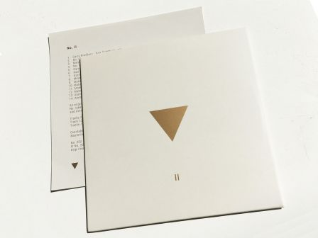 No. II - Limited Edition Compact Disc (CD) : Deluxe No. package with white / gold inner sleeve.